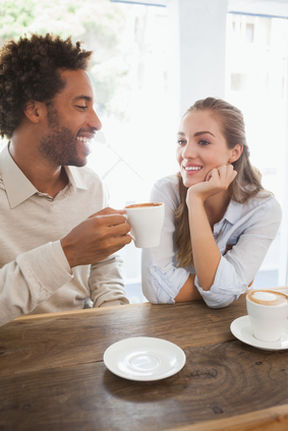 Happy couple on a date having coffee at the coffee shop